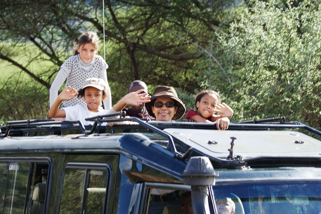 Family in a 4x4 during a game drive